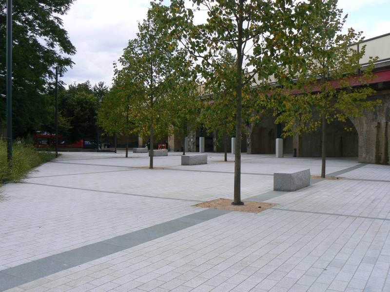 Silver Grey Granite Paving with Green and Yellow Granite. Lewisham Open Space' London.