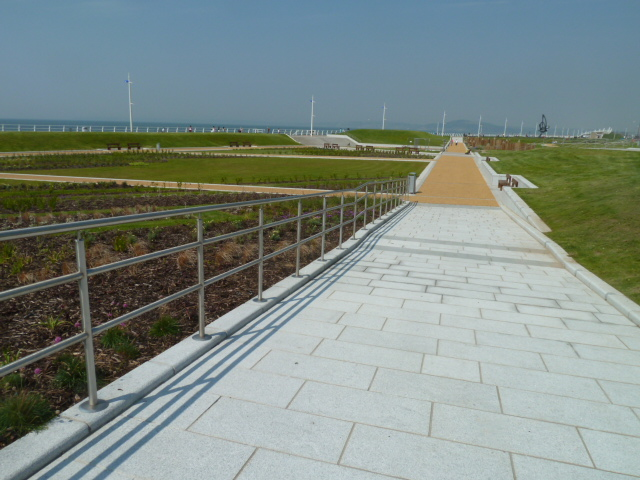 Silver grey granite paving with bullnosed kerb at Aberafon Seafront' Wales. For further images and information on this project please visit our Projects-Public Spaces gallery.