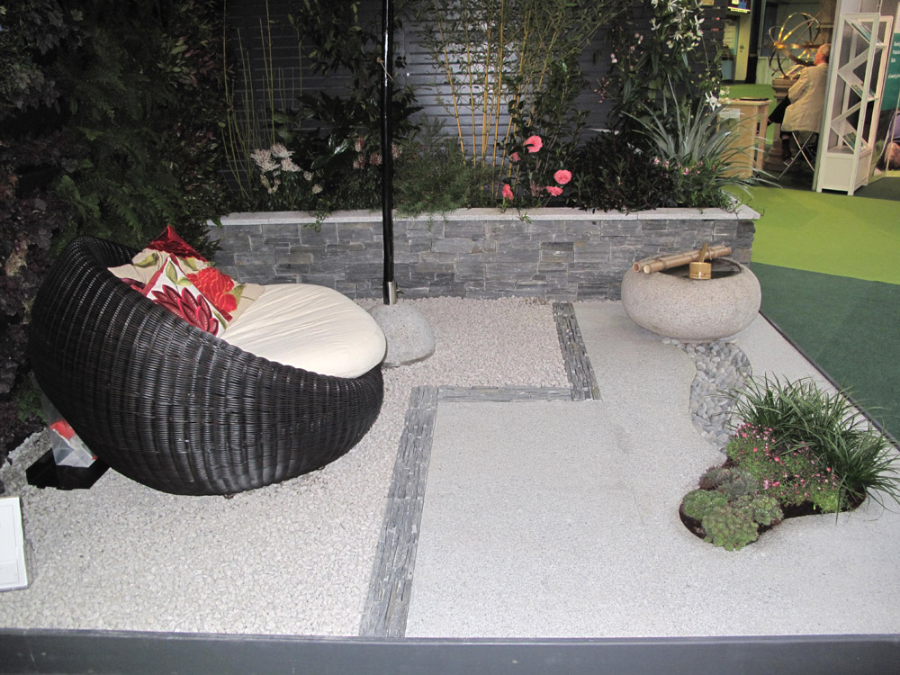 Silver grey granite paving used in a show garden at the LANDSCAPE Show 2012. Other products used were silver grey granite aggregate' flat grey pebbles' black slate Tier and thin slate Tier. Garden by The Constant Gardener Design.co For further images please visit our Projects Gallery.