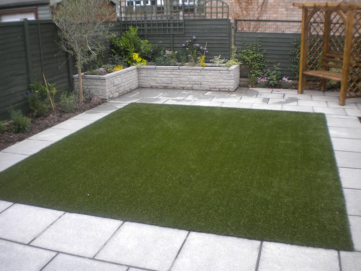 Silver Grey Granite Paving. Private Garden' designed and built by John Charles Landscapes.