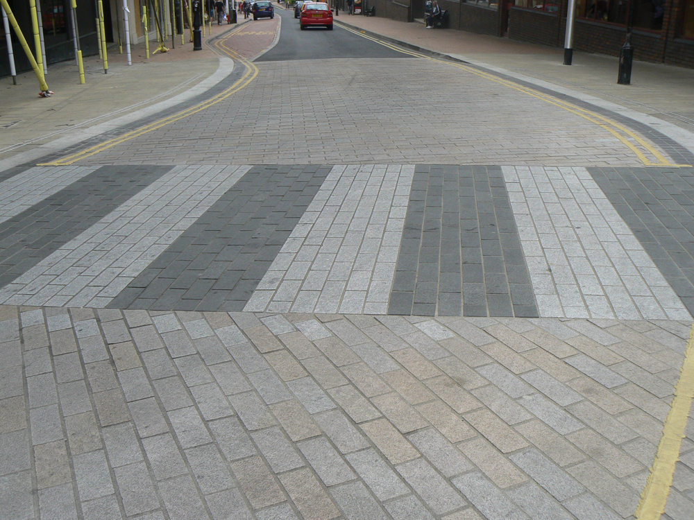 Black basalt with silver grey and pink granite imperial setts. For further images and info on this job please visit our Projects Gallery.