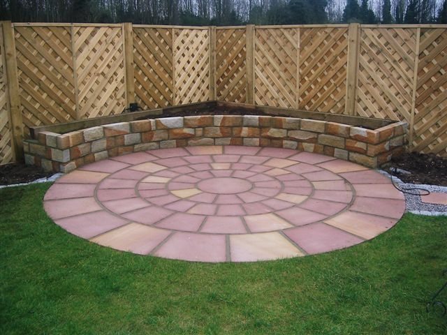 Pink Sandstone Circle. Private Garden' pictured here when wet.