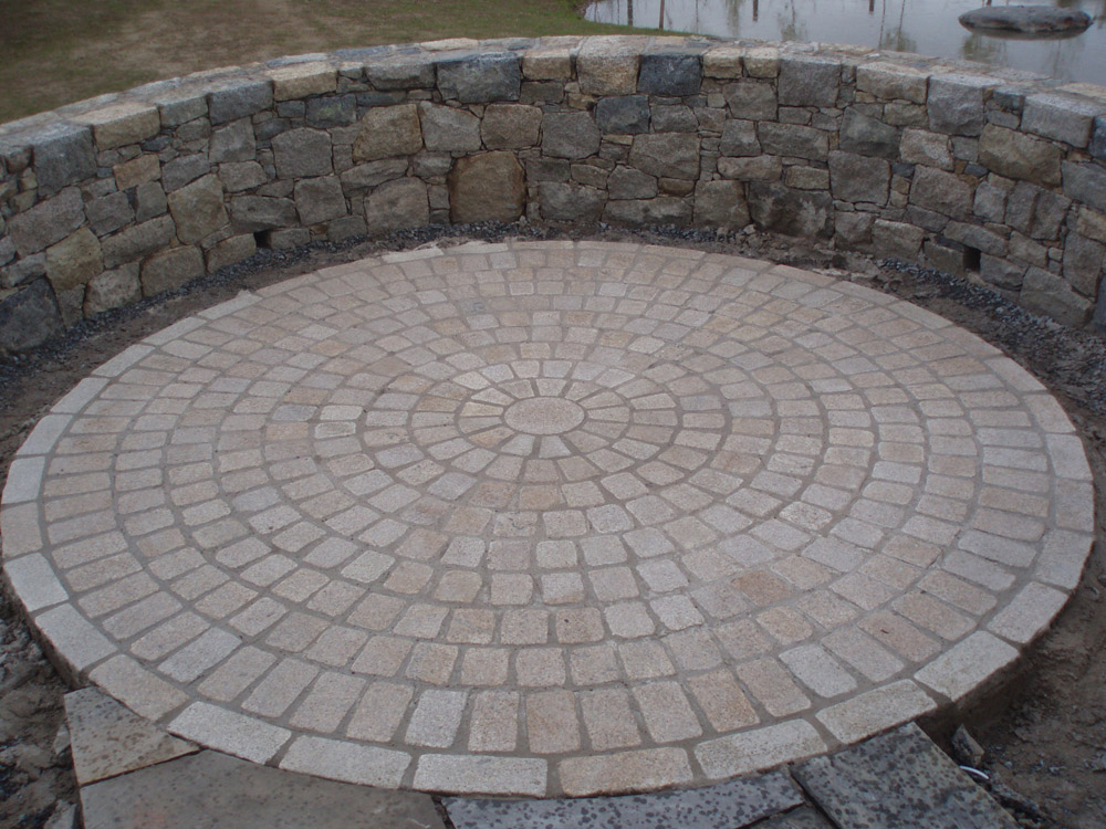 Yellow temple sett circle feature. Private garden' in Ireland' designed and built by Ben McKee Landscapes.