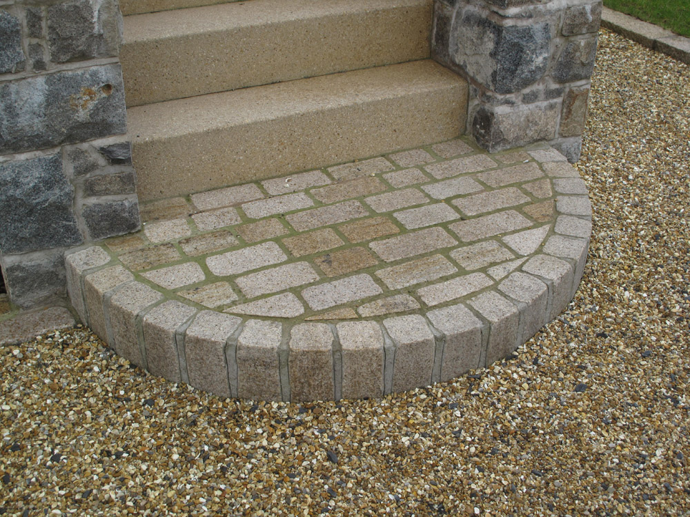 Yellow temple sett step feature (pictured here when wet). Private house in Ireland.