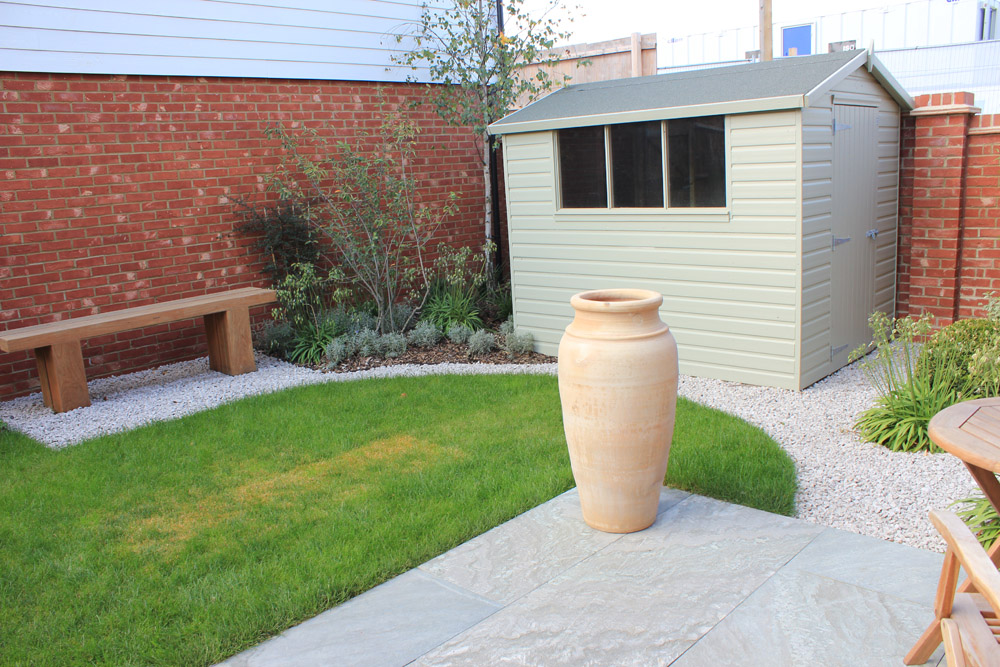 White Limestone aggregate 20mm and Ebony Cloud paving. Show garden' Crest Nicholson Eastern. Garden designed and built by The Land Design Partnership. For further images of this job please visit our Projects-Private Places Gallery.