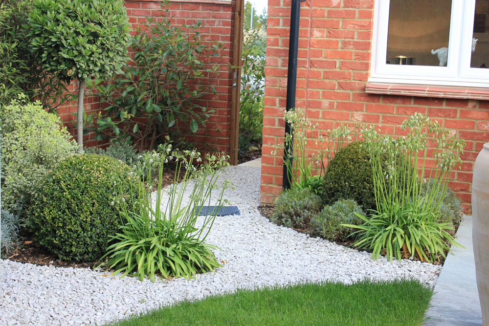White Limestone aggregate 20mm. Show garden' Crest Nicholson Eastern. Garden designed and built by The Land Design Partnership. For further images of this job please visit our Projects-Private Places Gallery.