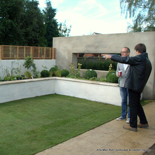 Yellow granite paving and coping with rustic granite tier panels. Private garden' featured on channel 4's Grand Designs. Designed by Ana Mari Bull and built by Legacy Gardens.