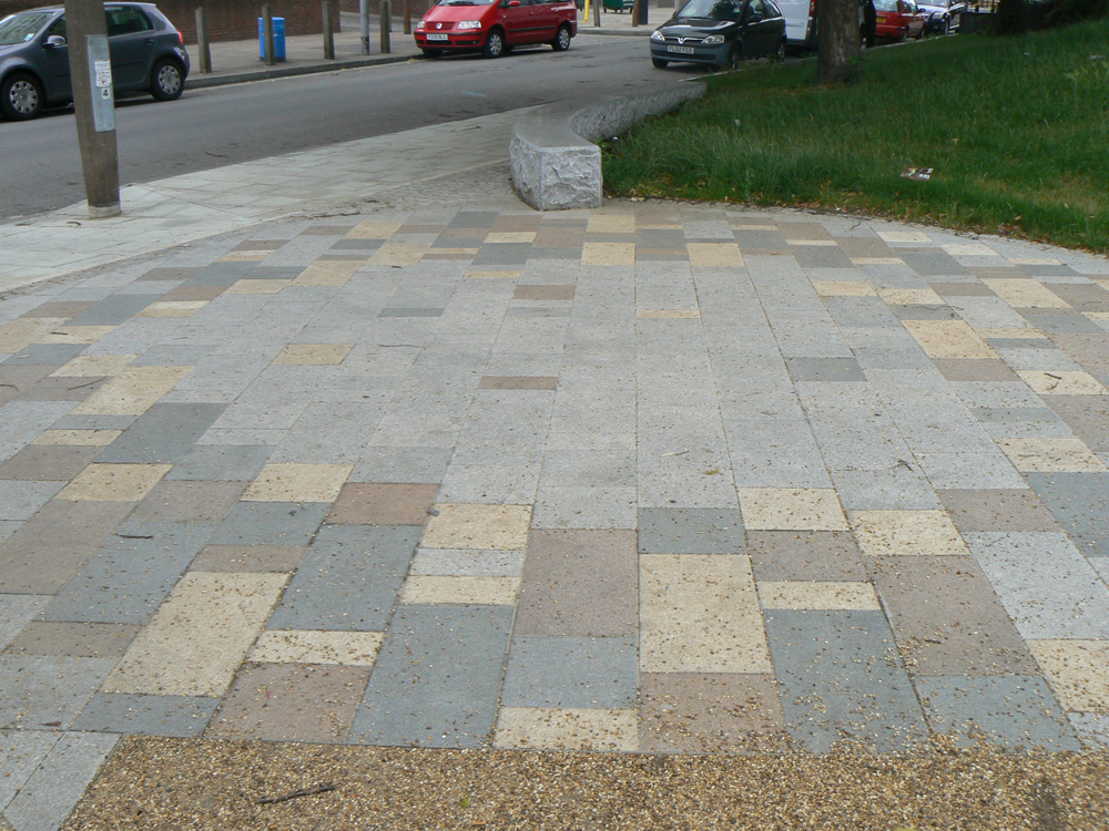 Yellow granite paving with silver grey' pink and blue grey granites. St George's Square' London. For further images and info on this job please visit our Project Gallery.