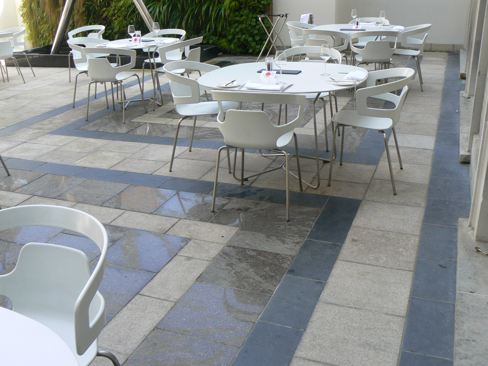 Yellow granite with black basalt and semi polished porphyry paving. RIBA Roof Terrace' London. For further images and info on this job please visit our Projects Gallery.
