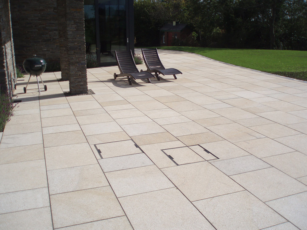 Yellow granite paving. Private garden in Ireland designed by Beth Moore and built by Ben McKee Landsapes. For further images of this job please visit our Projects Gallery.