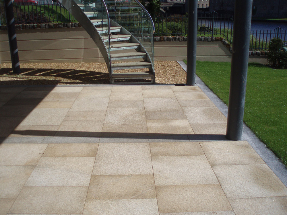 Yellow granite paving with silver grey granite kerb and golden flint gravel. Private garden' in Ireland' designed by Maurice Maxwell Garden Designs and built by Spring Landscapes. For further images of this job please visit our Projects Gallery.
