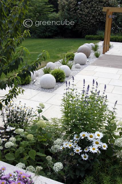 Yellow Granite Paving' private garden by Greencube Garden and Landscape Design.