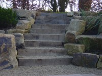 Yorkstone rockery with buff thames aggregate' private garden.