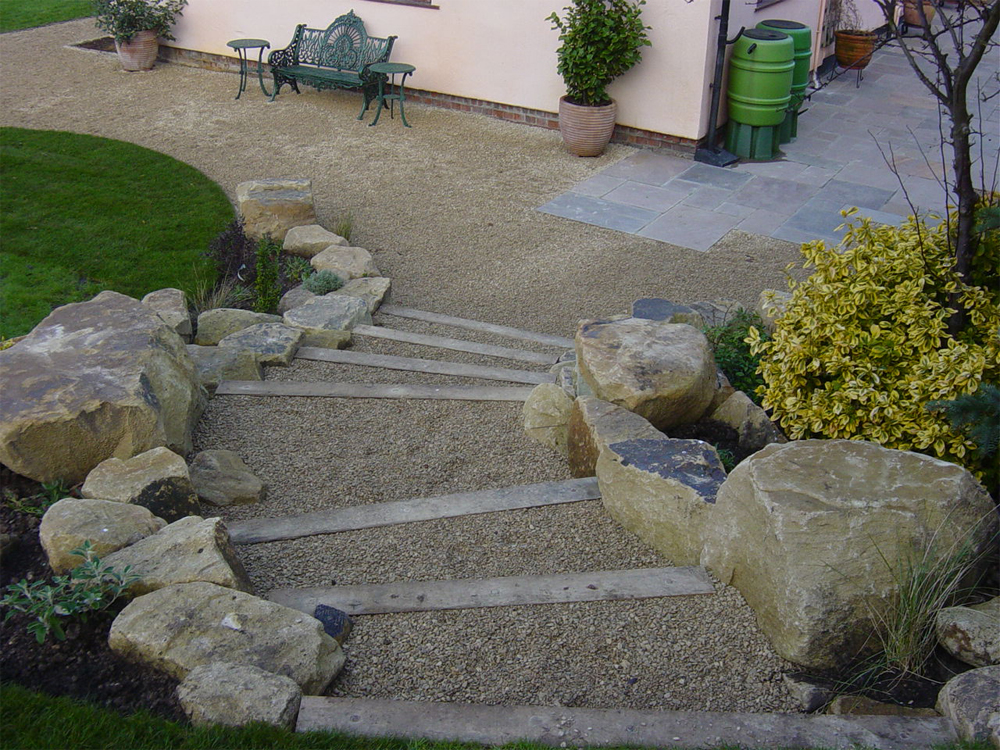Buff Thames Aggregate and Yorkstone Rockery. Private Garden designed and built by New Eden Landscapes.