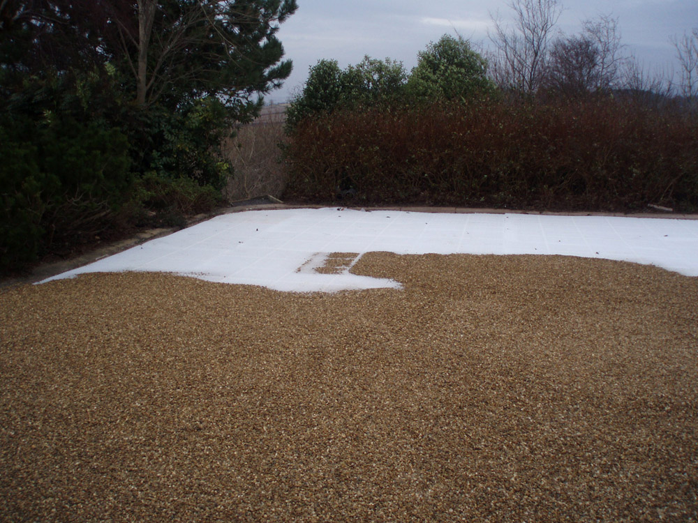 Cedagravel® filled with golden flint gravel. Private driveway in Ireland.