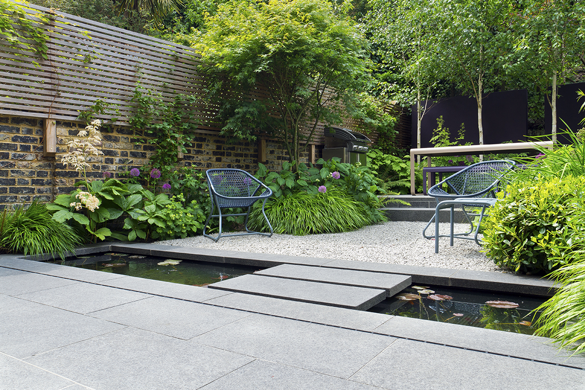 CEDAgravel in a private garden, showing that the garden furniture lays flat and does not sink in.  Garden designed by John Davies and built by Hortus Blackheath Ltd.