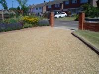 Cedagravel® driveway filled with Golden Flint Gravel.