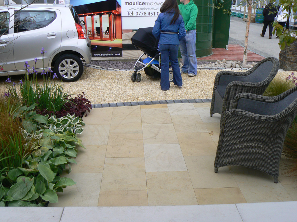 Cedagravel® pathway filled with buff flint gravel. Also pictured is the buff sandstone paving and black limestone setts. Balmoral Show 2012. For further images and information of this garden please visit our Private Places-Show Gardens Gallery.
