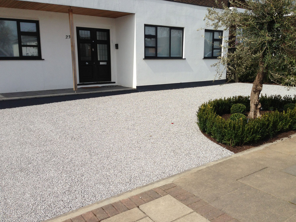 Silver grey granite aggregate laid in Cedagravel. Private driveway by Arbour Design & Build.