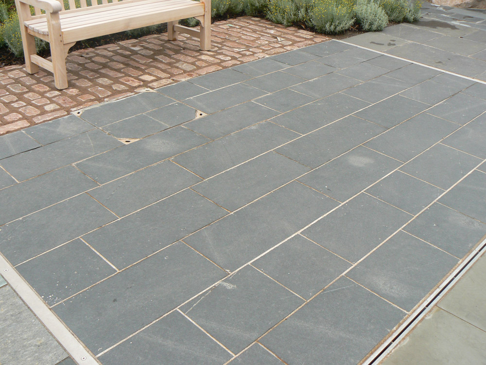 <p>Dark Grey Cumbrian Slate</p>  <p>S37/241/699</p>  <p>Sawn & flame textured</p>  <p>300mm x 20mm x RL</p>  <p>This paving is readily available</p>