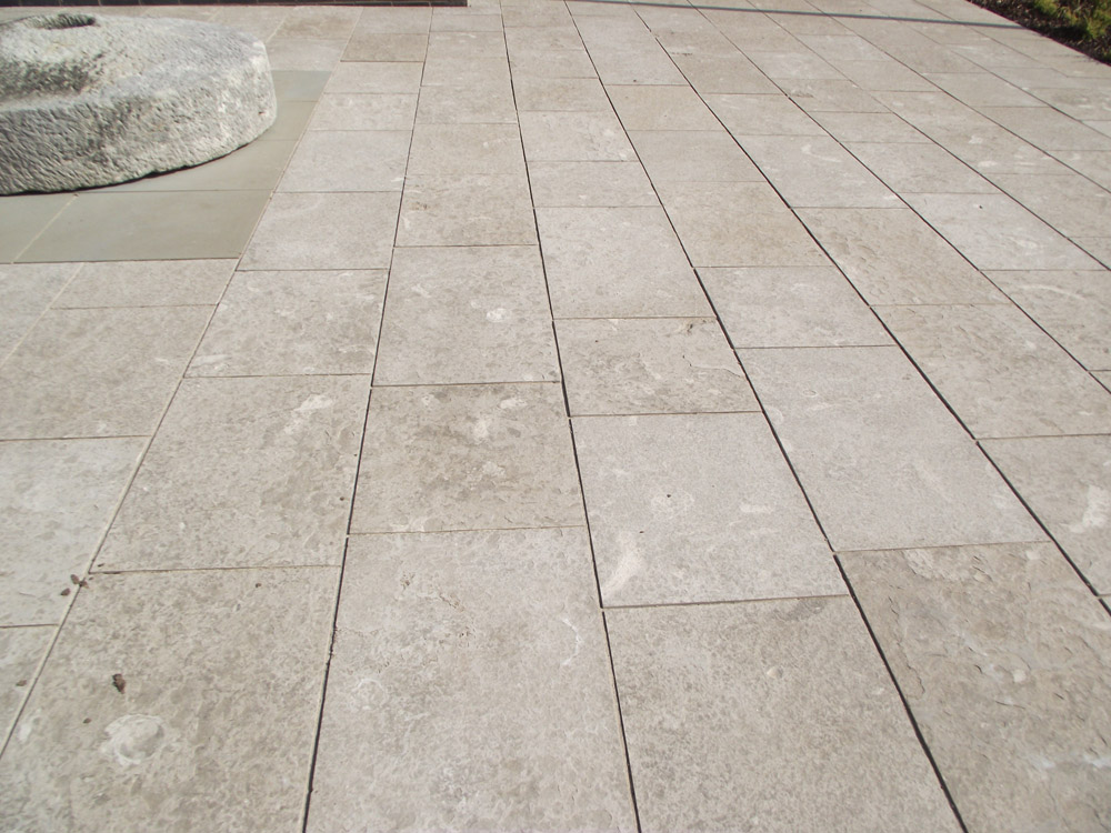 <p>Baycliff Limestone</p>  <p>  S37/241/1961</p>  <p>  Sawn &amp; flame textured</p>  <p>  400mm x 50mm x RL</p>  <p>  This paving is readily available</p>