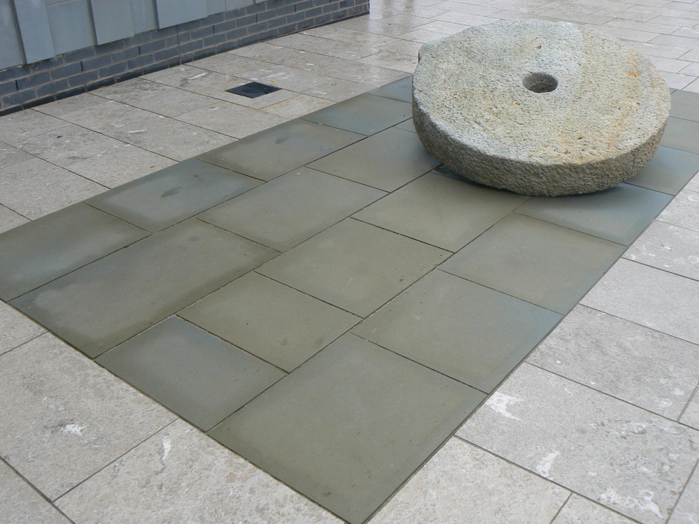 <p>Forest of Dean Sandstone' pictured here when wet</p>  <p>  S11/179/2041</p>  <p>  Sawn</p>  <p>  500mm x 50mm x RL</p>  <p>  This paving is readily available</p>