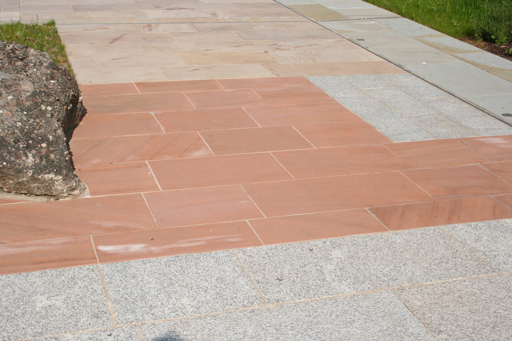 <p>Scottish Red Sandstone</p>  <p>203/657/1039</p>  <p>Sawn</p>  <p>400mm x 50mm x RL</p>  <p>This paving is readily available</p>