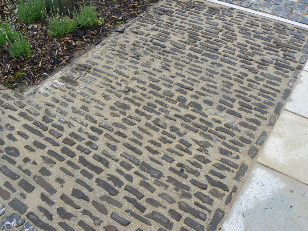 <p>Reclaimed Ironstone Setts</p>  <p>Subject to availability</p>  <p>25-40mm wide x 100-150mm long x 90mm deep</p>