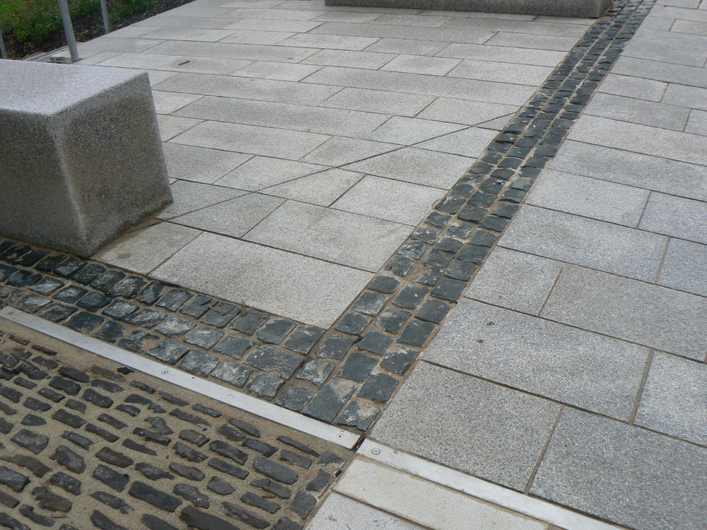 <p>Basalt Setts' Very Dark Grey</p>  <p>S282/21283/2040</p>  <p>Flame textured top with cropped sides</p>  <p>100x100mm in plan and 50mm deep' however they were actually laid on their sides in error</p>